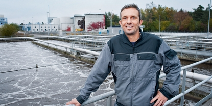 Engineer in front of a wastewater plant
